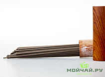 Baseless incense agarwood in a wooden tube